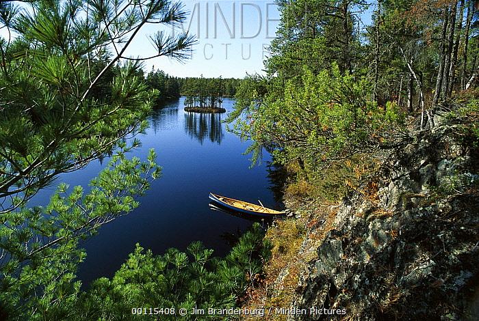 Canoe tied up at lake edge, Boundary Waters Canoe Area Wilderness, Minnesota  -  Jim Brandenburg