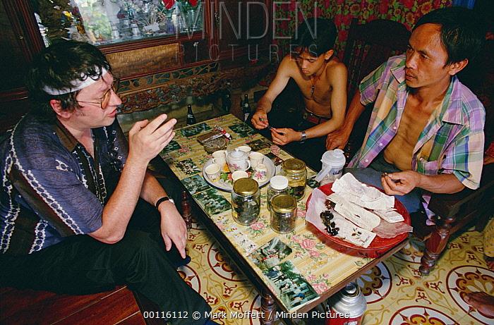 Local animal trader with a German snake buyer, Tam Dao National Park, Vietnam  -  Mark Moffett