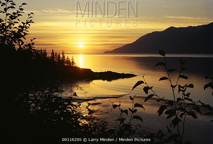 Sunset over bay, Hope, Alaska  -  Larry Minden