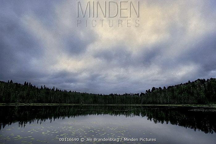 Storm over lake, Northwoods, Minnesota  -  Jim Brandenburg