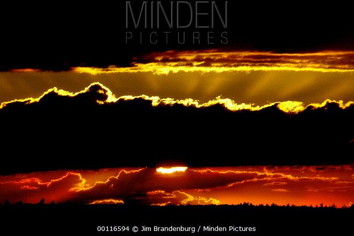 Sunset over Moose Lake, Northwoods, Minnesota  -  Jim Brandenburg