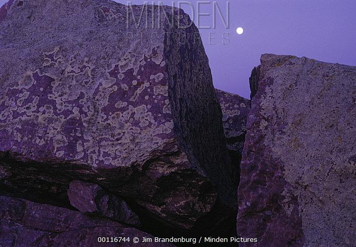 Lichen-covered rocks and full moon, Blue Mounds State Park, Minnesota  -  Jim Brandenburg