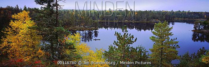 Tourist canoeing on lake, Boundary Waters Canoe Area Wilderness, Minnesota  -  Jim Brandenburg