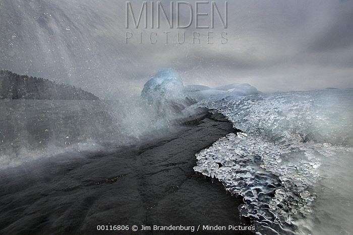 Ice and crashing wave along Shovel Point, Lake Superior, Minnesota  -  Jim Brandenburg