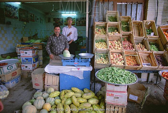 Storekeepers with produce in shop, Bandar Abbas, Iran  -  Mark Moffett