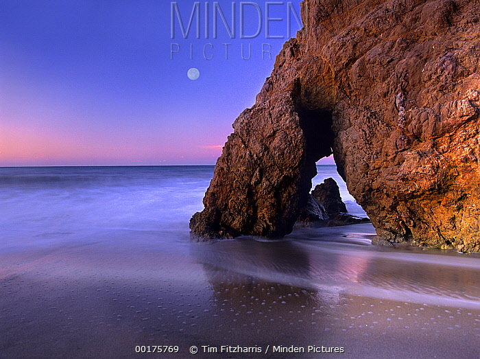 Sea arch and full moon over El Matador State Beach, Malibu, California  -  Tim Fitzharris