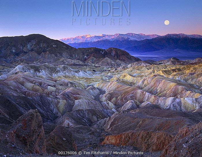 Full moon setting over Zabriskie Point, morning,  Death Valley National Park, California  -  Tim Fitzharris