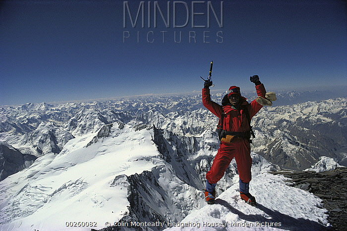 Climber on the summit of Pik Kommunizma at 7,500 meters elevation, highest mountain in the Pamirs, a mountain range in Tajikistan, central Asia  -  Colin Monteath/ Hedgehog House