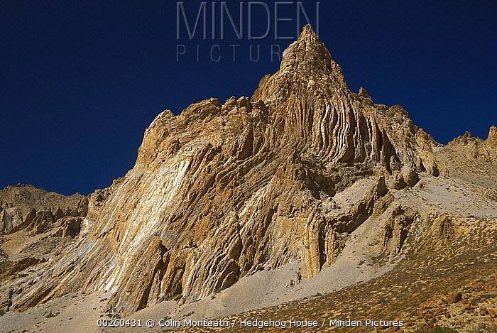 Rock pinnacle with folds, alpine desert, Ladakh, northwest India, Himalaya  -  Colin Monteath/ Hedgehog House