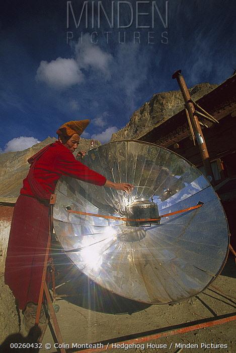 Monk boiling water with solar reflector, Lingshet Monastery, Ladakh, northwest India  -  Colin Monteath/ Hedgehog House