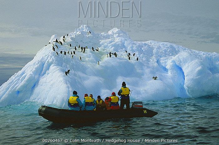 Tourists cruise past iceberg, Dumont d'Urville, Terre Adelie Land, east Antarctica  -  Colin Monteath/ Hedgehog House