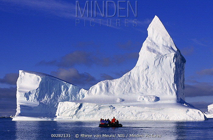 Tourists in zodiac near iceberg, Antarctica  -  Rhinie van Meurs/ NIS