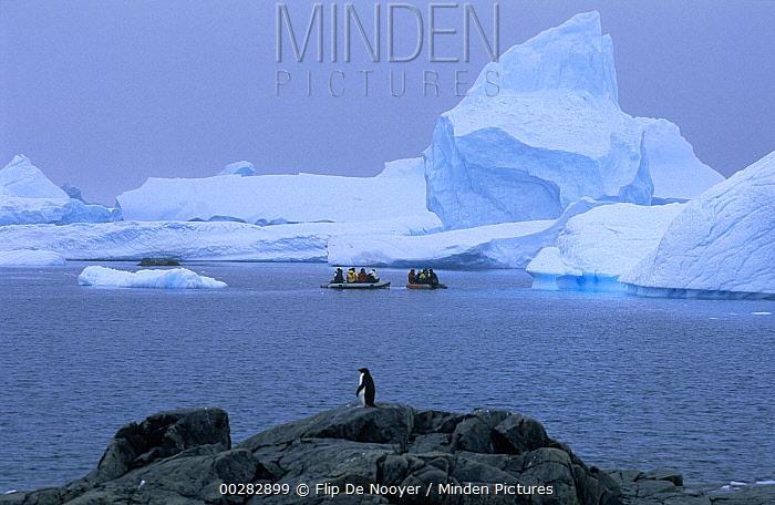 Tourists in zodiacs tour icebergs, South Georgia Island  -  Flip de Nooyer