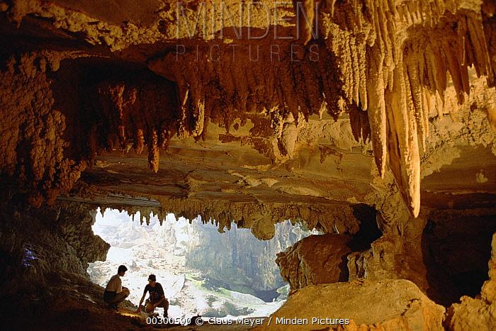 Visitors explore an expansive cavern with stalactites, Vale Do Peruacu, Minas Gerais, south Cerrado savannah, Brazil  -  Claus Meyer