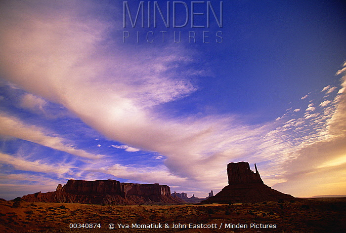 Cirrus and cumulus clouds over Mittens, a group of sandstone mesas, Monument Valley Navajo Tribal Park, Arizona  -  Yva Momatiuk & John Eastcott