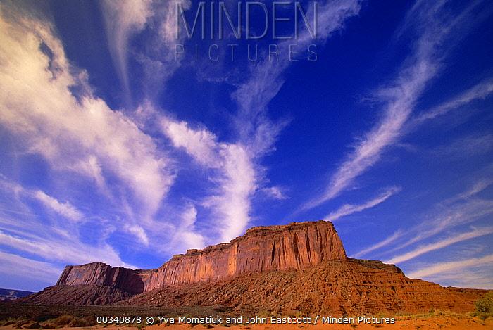 Cirrus and cumulus clouds over mesa, Monument Valley Navajo Tribal Park, Arizona  -  Yva Momatiuk & John Eastcott