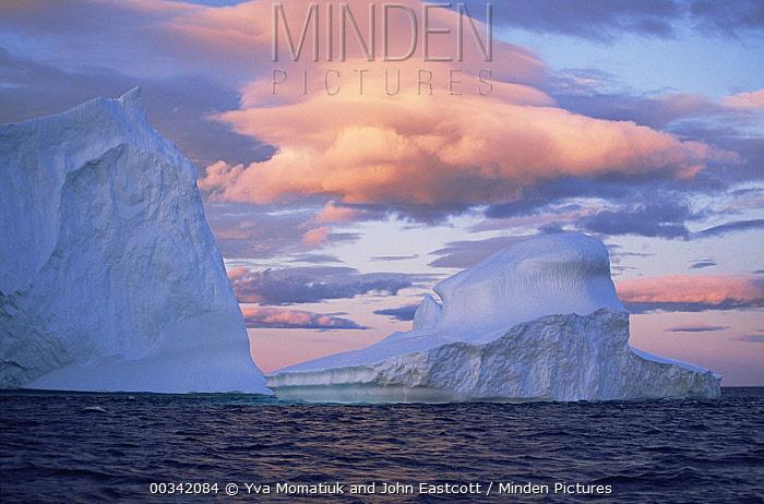 Iceberg drifting in Labrador Sea current, early evening light, summer season, Labrador, Newfoundland, Canada  -  Yva Momatiuk & John Eastcott
