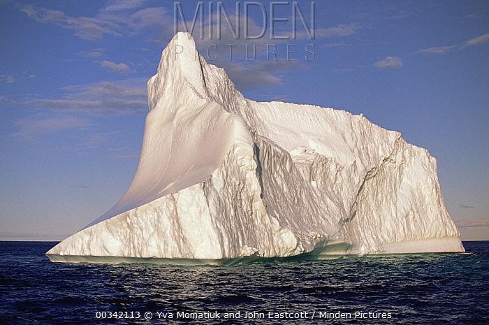 Iceberg drifting south in Labrador current, illuminated by early evening sunlight, summer season, Labrador Sea, northern Labrador, Canada  -  Yva Momatiuk & John Eastcott