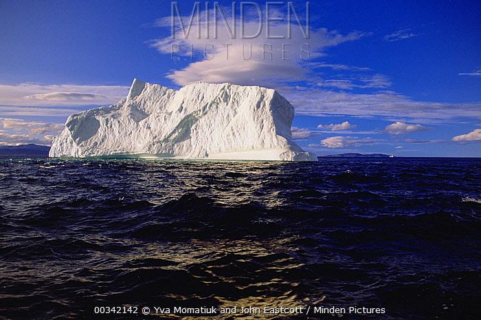 Iceberg floating in Labrador Sea current in the evening sun, Labrador Sea, Newfoundland, Canada  -  Yva Momatiuk & John Eastcott