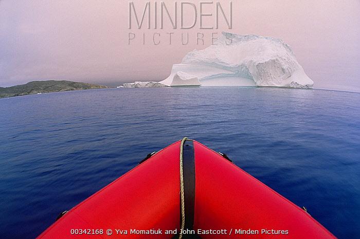 View from bow of red rubber boat heading toward floating iceberg in summer, Labrador Sea, Labrador, Canada  -  Yva Momatiuk & John Eastcott