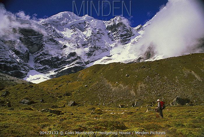 Trekker under Mera Peak, Hinku Valley, Makalu-Barun National Park, Nepal  -  Colin Monteath/ Hedgehog House