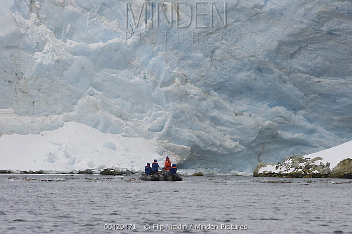 Tourists in inflatable boat viewing glacier, South Georgia Island  -  Flip  Nicklin