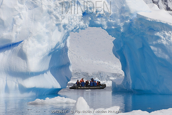 Tourists checking out iceberg from inflatable boat from the Endeavour cruise ship, Antarctica  -  Flip  Nicklin