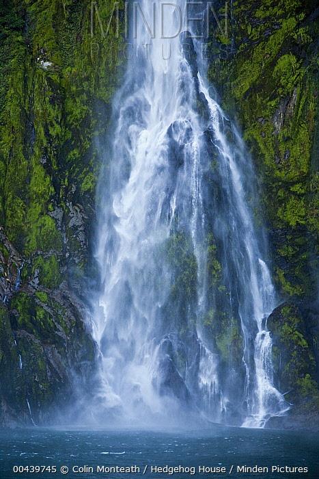 Stirling Falls drops into Milford Sound, Fiordland National Park, New Zealand  -  Colin Monteath/ Hedgehog House