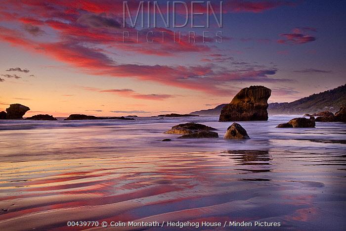 Sunset on beach north of Punakaiki, Paparoa National Park, New Zealand  -  Colin Monteath/ Hedgehog House