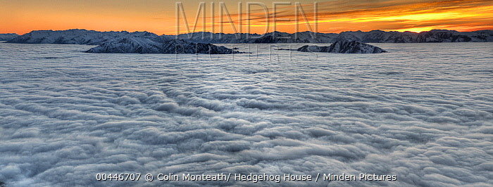 Sea of clouds cover Lake Wanaka, seen from Mount Roy, sunrise over Southern Alps, Otago, New Zealand  -  Colin Monteath/ Hedgehog House