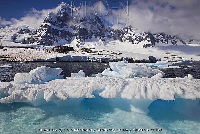 Iceberg in front of Port Lockroy base and museum, Wiencke Island, Antarctic Peninsula, Antarctica  -  Colin Monteath/ Hedgehog House