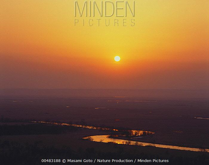Kushiro Marsh at sunset, Hokkaido, Japan  -  Masami Goto/ Nature Production
