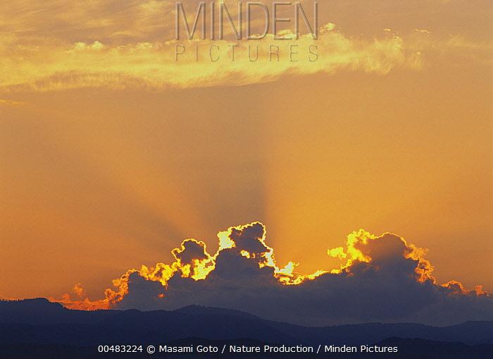 Ray of light over clouds, Hokkaido, Japan  -  Masami Goto/ Nature Production
