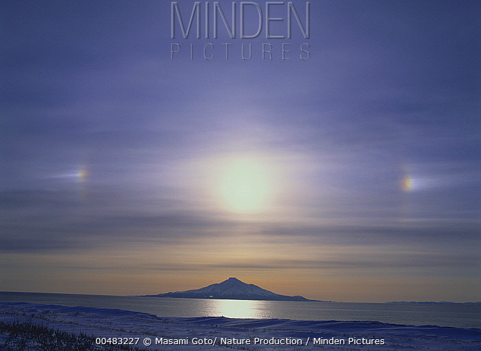 Mount Rishiri, extinct volcano with parhelion phenomenon overhead, Hokkaido, Japan  -  Masami Goto/ Nature Production