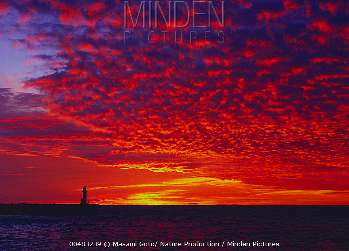 Lighthouse at Utoro at sunset, Hokkaido, Japan  -  Masami Goto/ Nature Production
