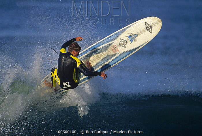 Surfer catching air, backside view  -  Bob Barbour
