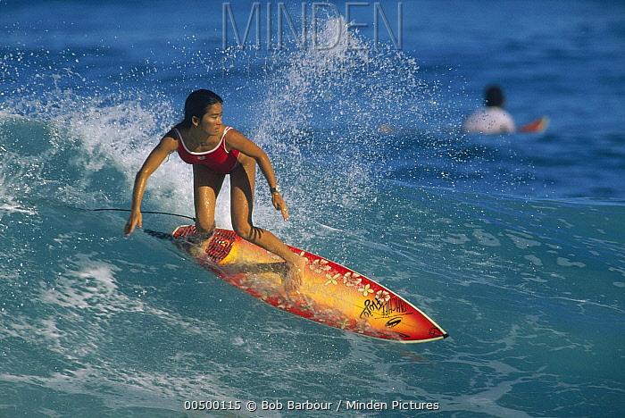 Woman surfer catching a wave  -  Bob Barbour