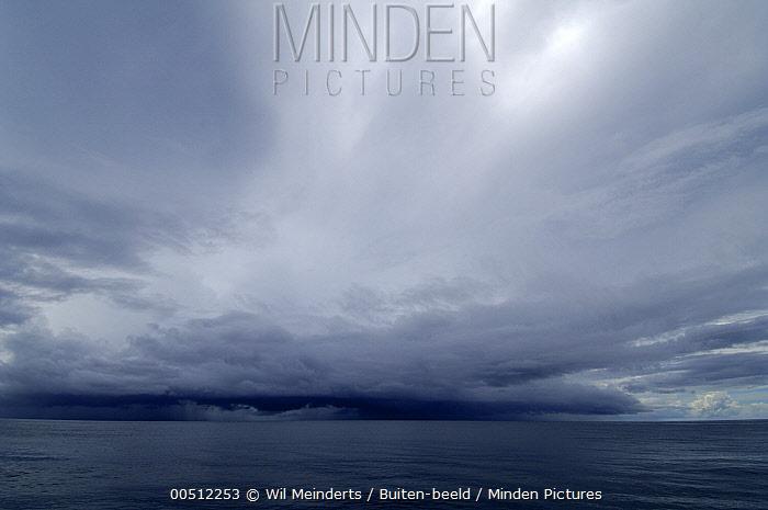 Storm clouds over the sea, Aldabra, Seychelles  -  Wil Meinderts/ Buiten-beeld