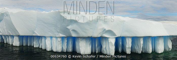 Iceberg showing distinctive melt pattern, Neko Harbor, Antarctic Peninsula, Antarctica  -  Kevin Schafer