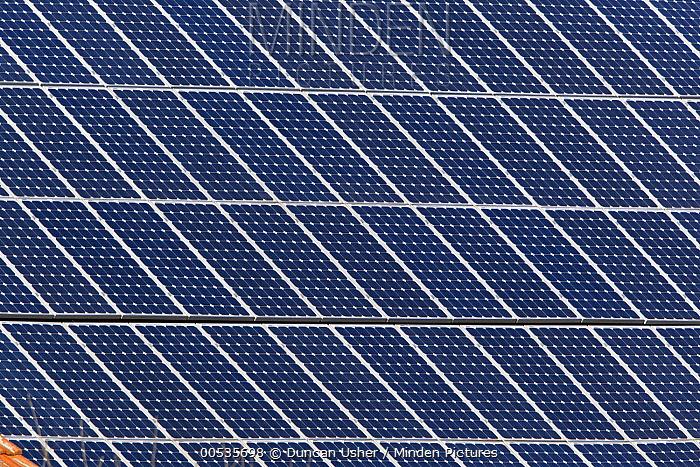 Solar panels on roof of house, Germany  -  Duncan Usher