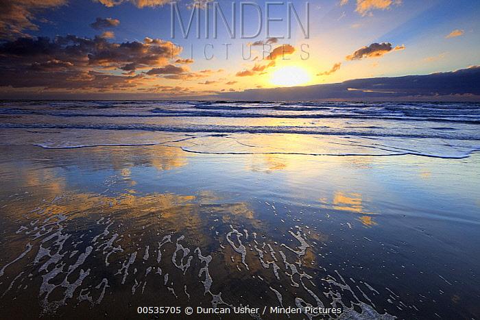 Sunset over ocean, Texel Island, North Sea, Netherlands  -  Duncan Usher
