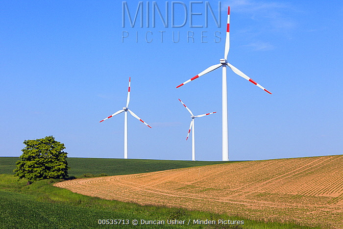 Wind turbines on agricultural fields, Germany  -  Duncan Usher