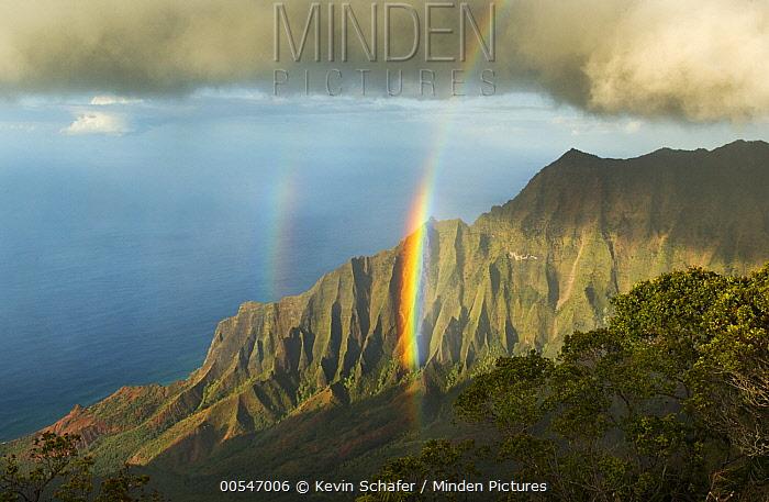 Rainbow over cliffs, Kalalau Valley, Na Pali Coast State Park, Kauai, Hawaii  -  Kevin Schafer