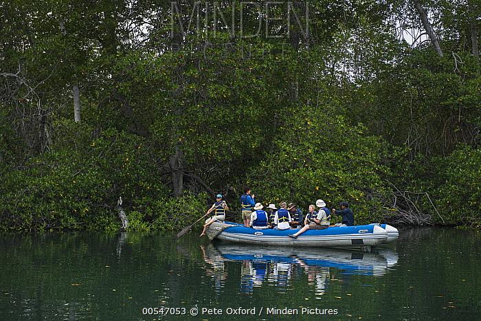 Tourists in boat, Isabela Island, Galapagos Islands, Ecuador  -  Pete Oxford