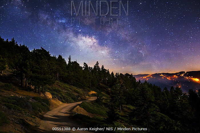 The Lake Fire, forest fire at night with the Milky Way south of Big Bear, San Bernardino National Forest, south of Big Bear, California  -  Aaron Keigher/ NIS