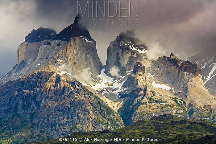 Mountain peaks shrouded in clouds, Torres del Paine, Torres Del Paine National Park, Patagonia,Chile