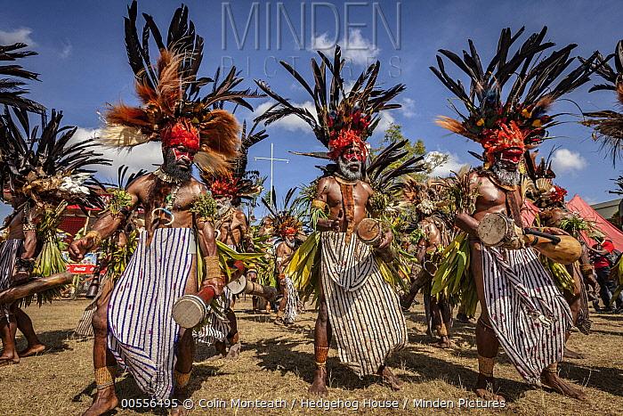 Men in ritual make-up and traditional clothing dancing during a sing-sing, Goroka Show, Goroka, Eastern Highlands, Papua New Guinea