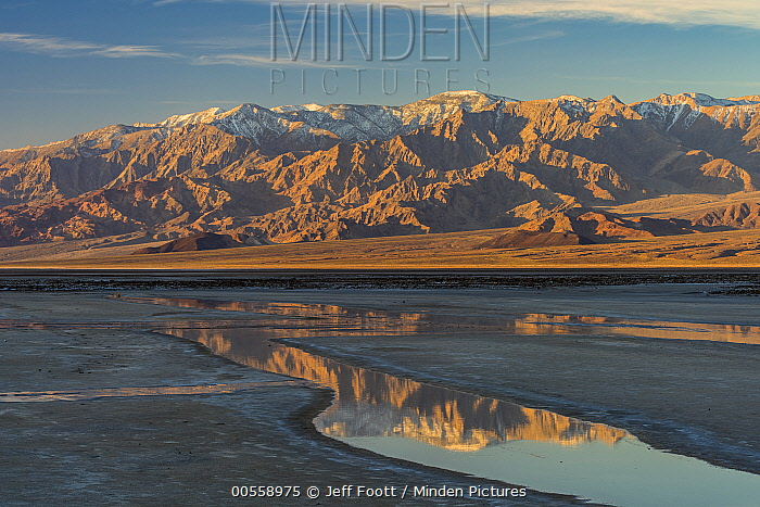 Mountain range reflected in water, Cottonball Basin, Death Valley National Park, California