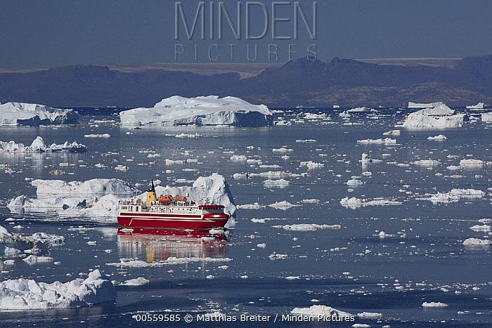 Ferry moving between icebergs, Ilulissat, Greenland
