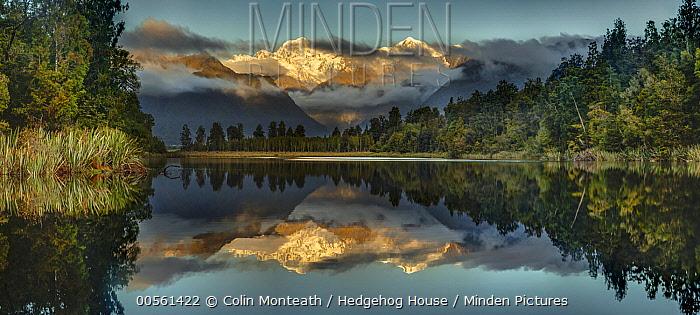Mountains reflected in lake at sunset, Lake Matheson, Mount Tasman and Mount Cook, Westland National Park, South Island, New Zealand